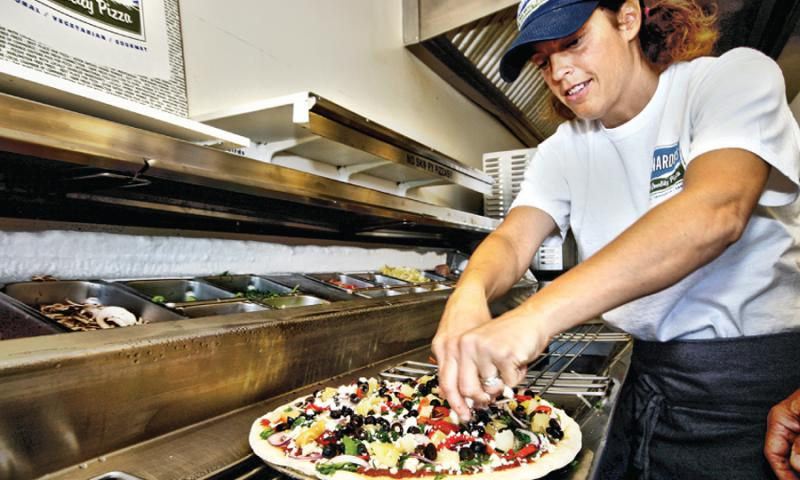 A pizza being made at Leonardo's Pizza in Portland, Maine.