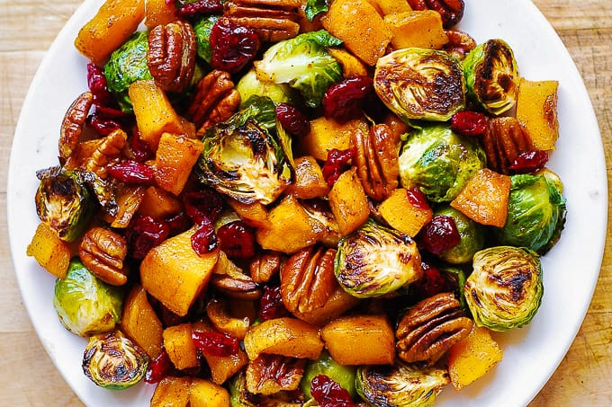 Brussels sprouts, butternut squash, pecans, and cranberries are the perfect flavor combination for a vegetarian Thanksgiving side.