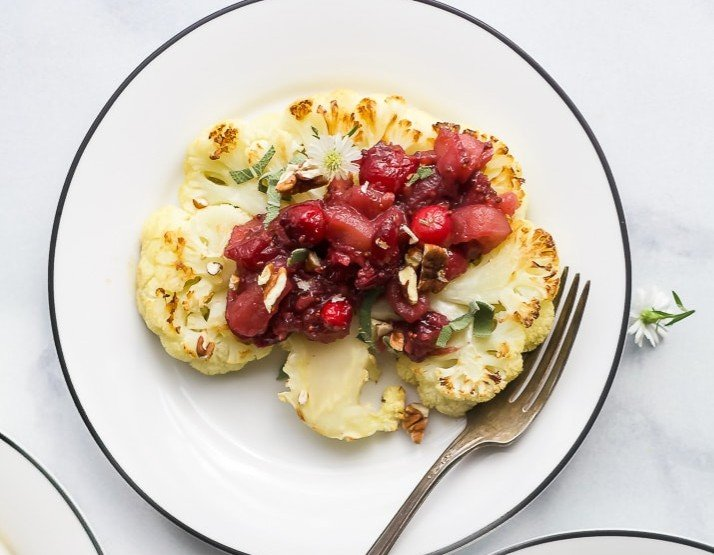Cauliflower steaks with apple cranberry chutney are an excellent vegetarian alternative to traditional Thanksgiving dishes.