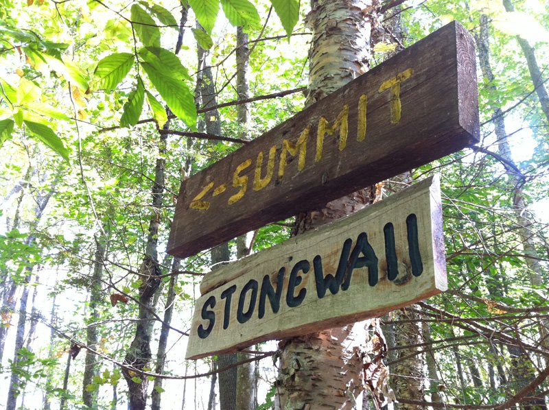 Summit and Stonewall signs at Hedgehog Mountain in Freeport, Maine