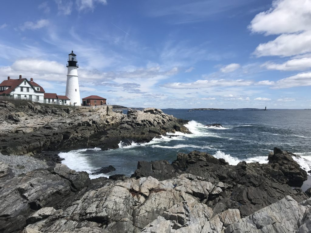 The Portland Headlight on a bright, cloudy day in Cape Elizabeth, Maine.