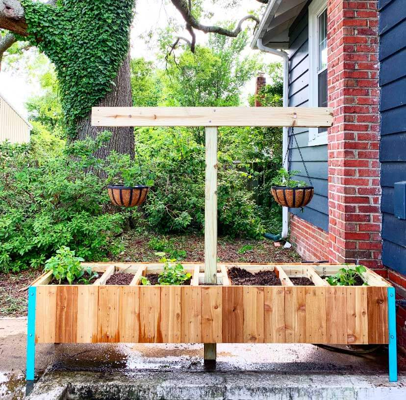 Raised garden bed with compost bins