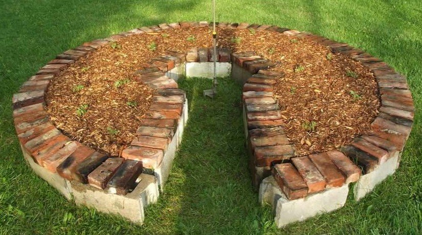 Keyhole raised bed built with reclaimed materials