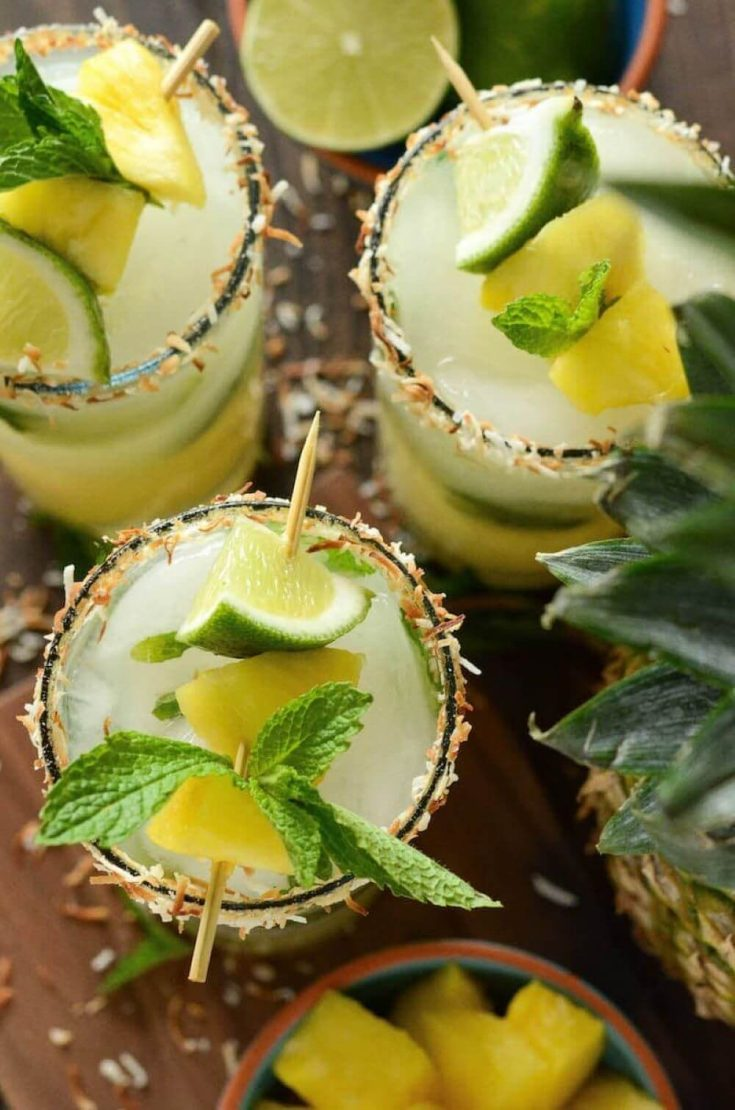 An overhead look at several pineapple coconut mojitos.