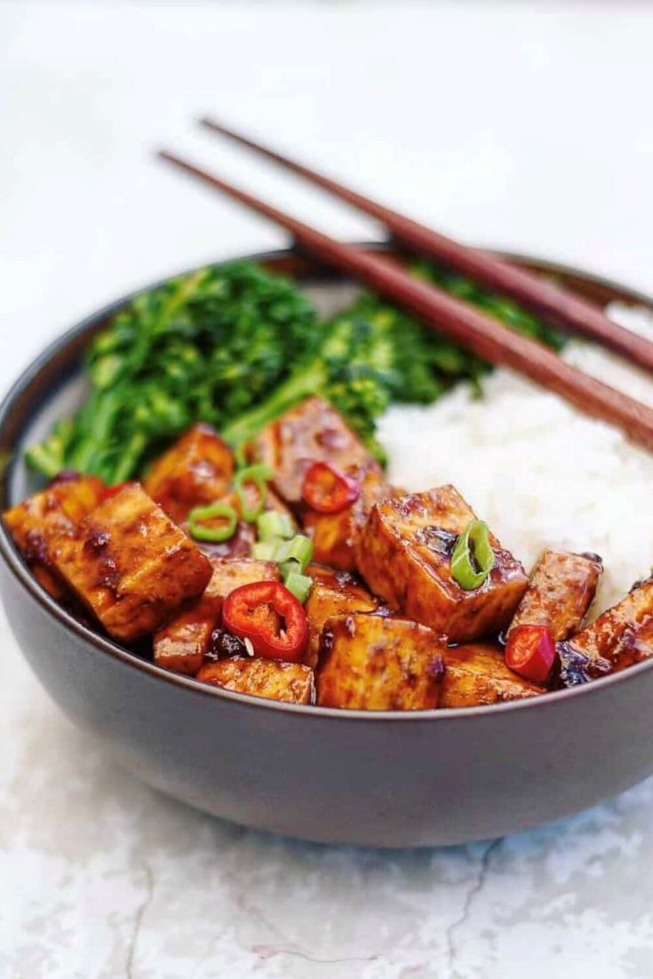 A large bowl of Asian BBQ tofu bowl served with rice and broccoli.