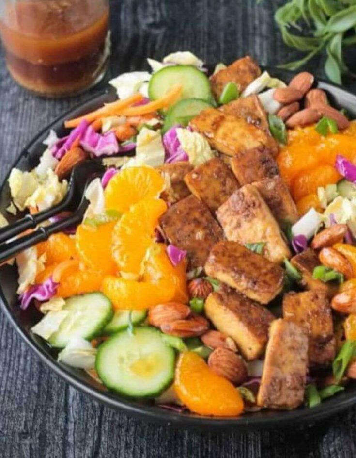 A delicious bowl of crunchy Asian salad with baked tofu.