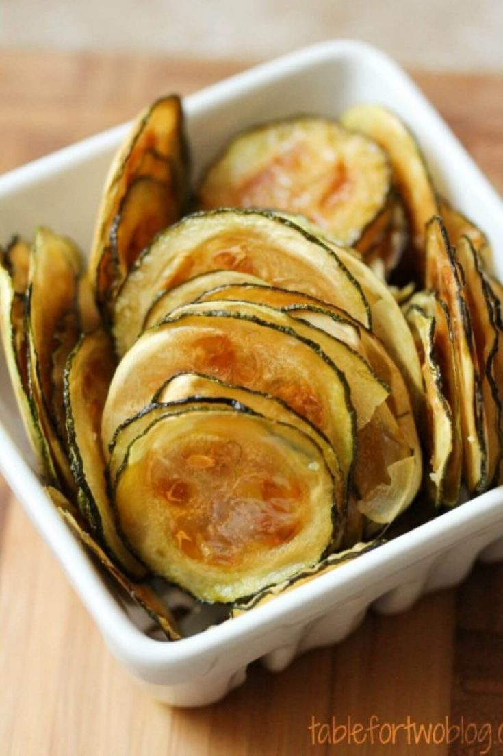 A small dish filled with easy oven-baked zucchini chips.