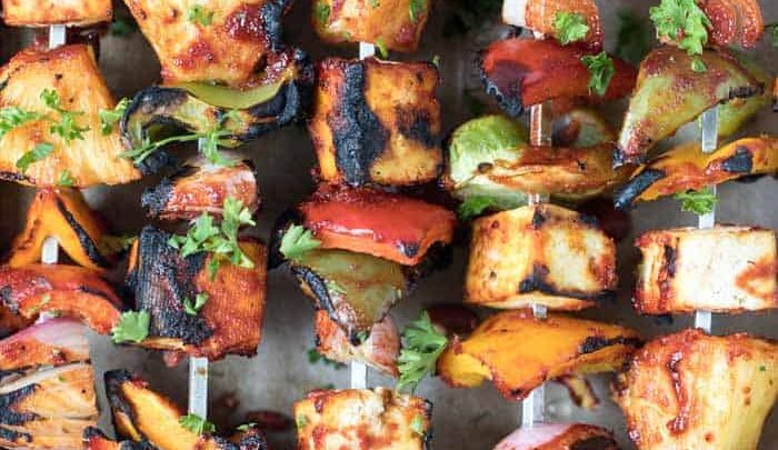 A tray full of barbecue pineapple tofu kebabs fresh off the grill.