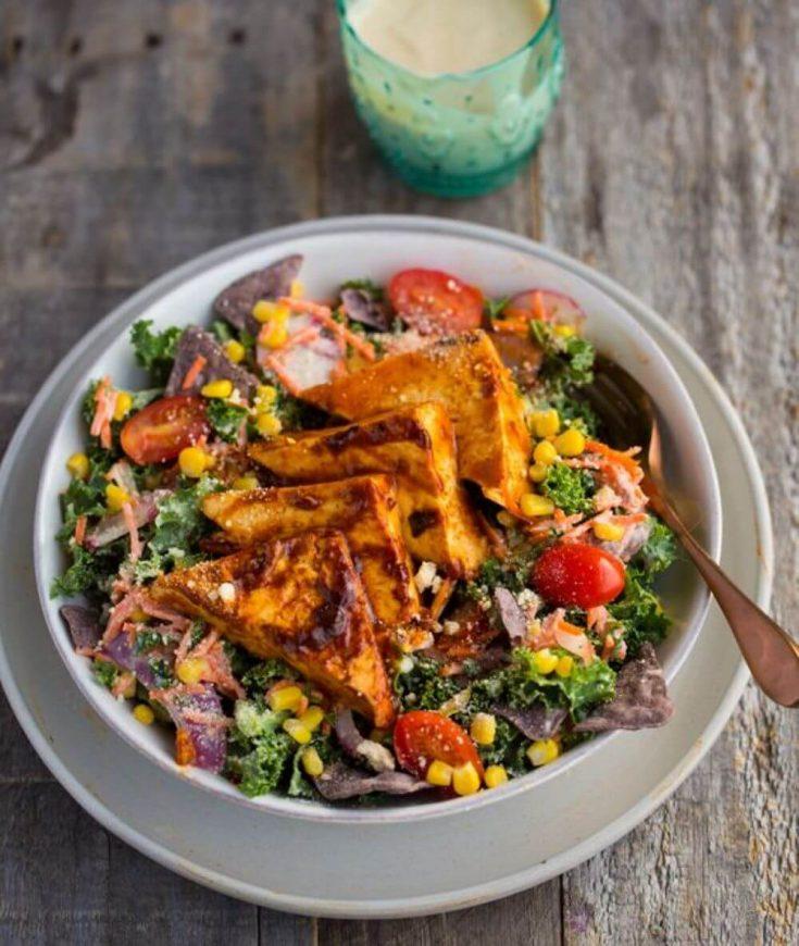 A large bowl of BBQ tofu corn kale ranch salad.