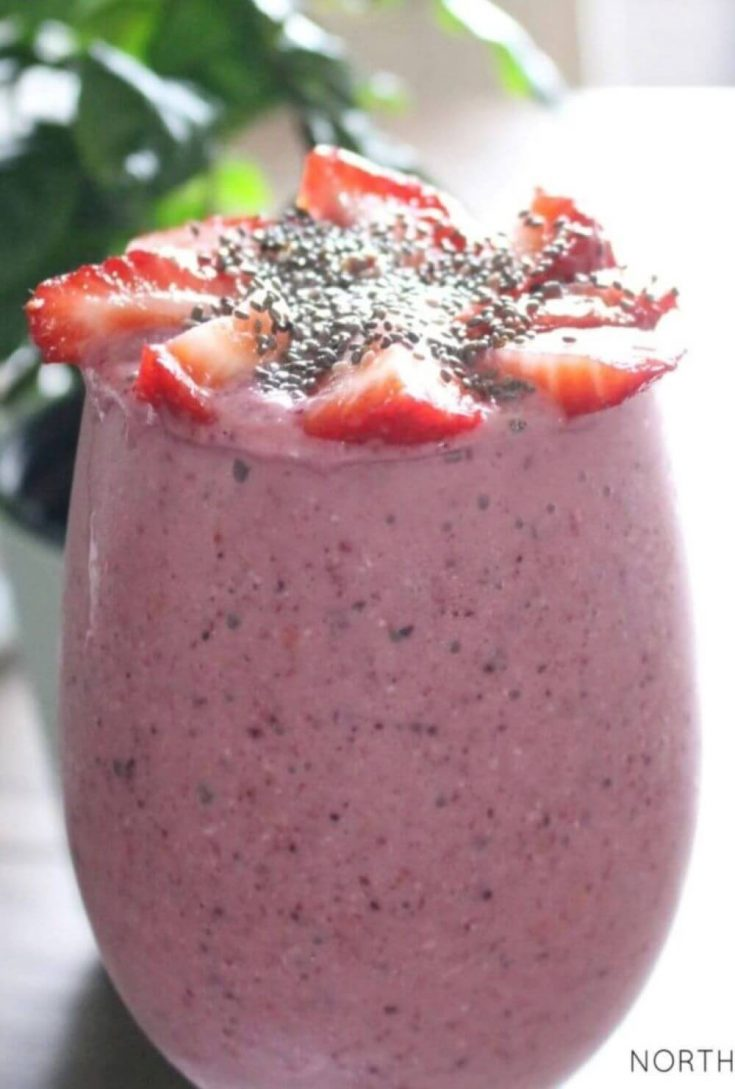 A close-up glass of energy boosting oatmeal berry breakfast smoothie.