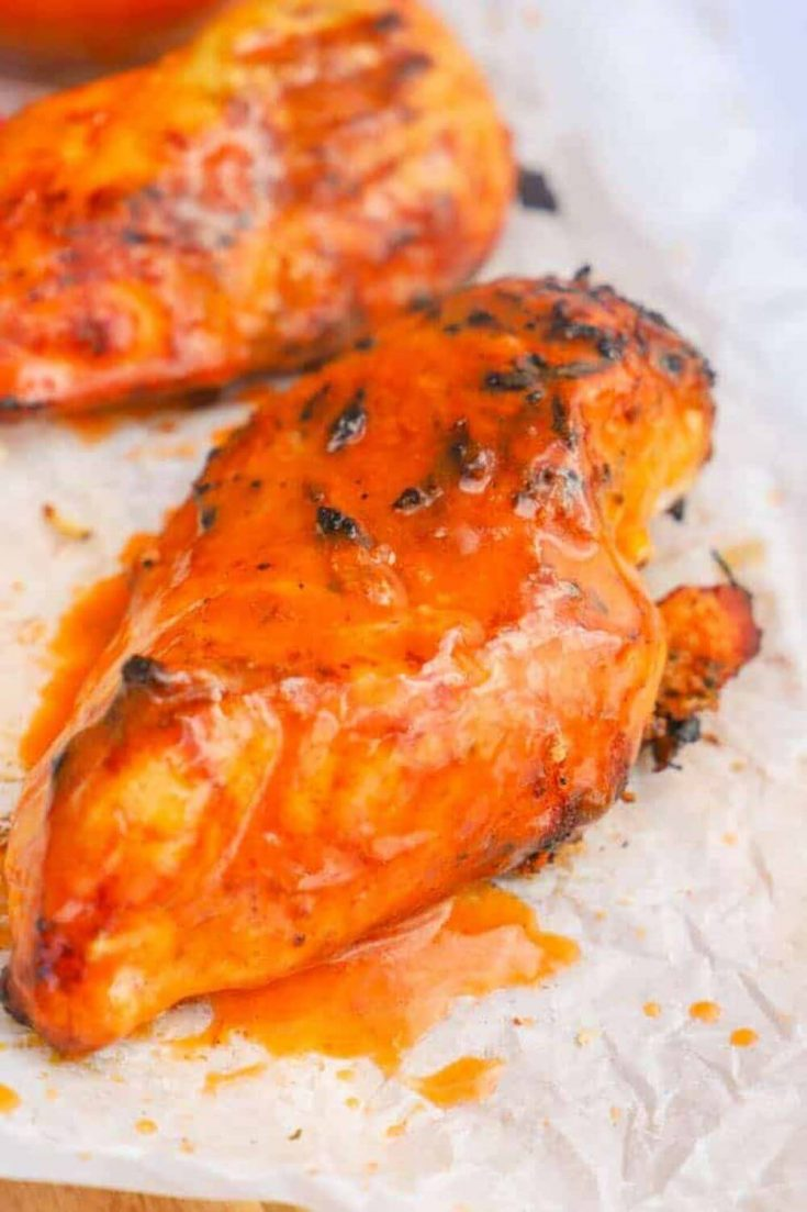 Two breasts of grilled buffalo chicken.