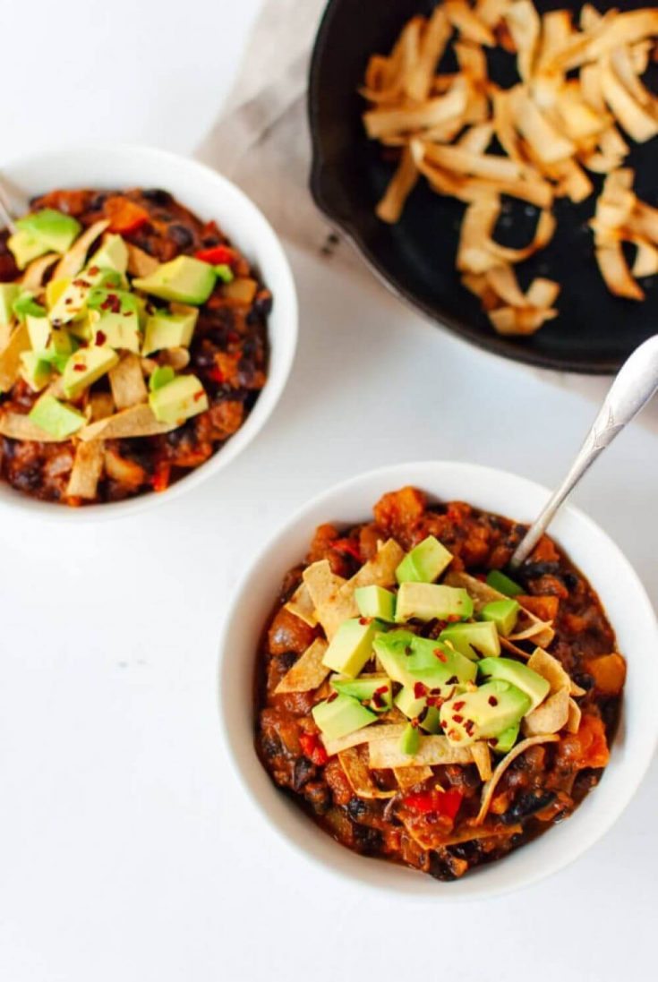 Two small white bowls filled with butternut squash chipotle chili.