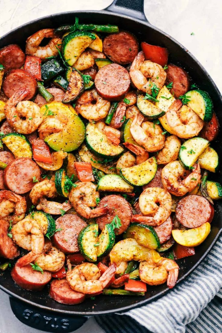 A delicious pan full of healthy cajun shrimp and sausage vegetable skillet.
