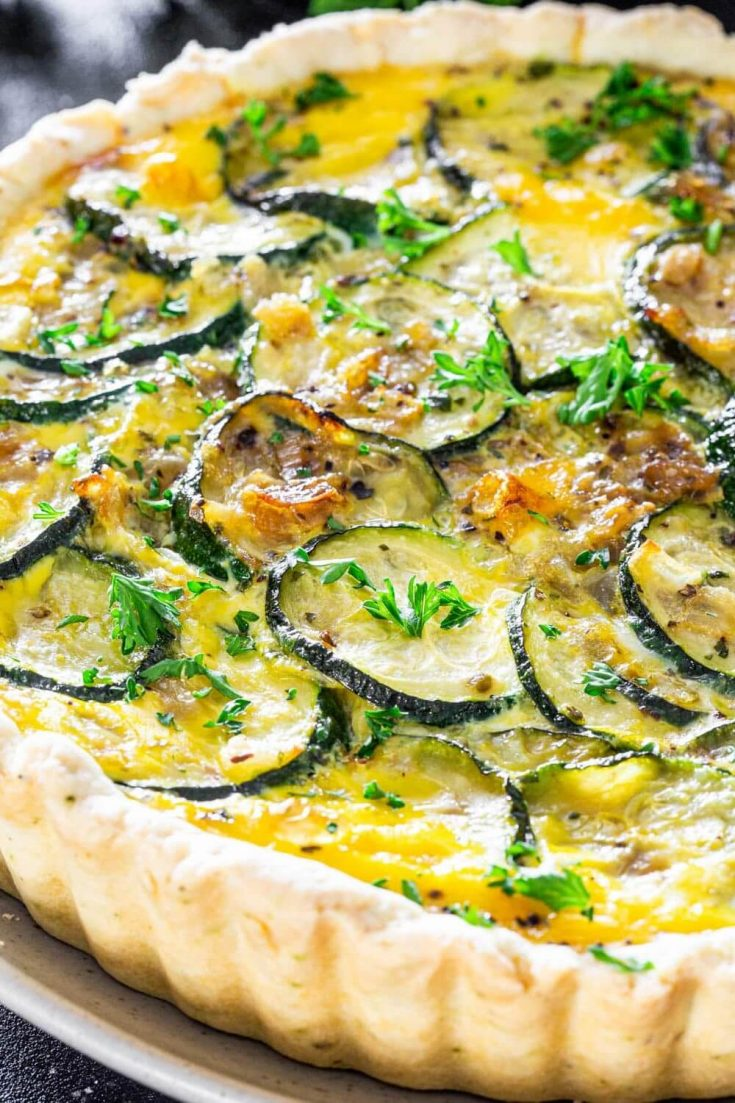 A large cheesy zucchini quiche right out of the oven.