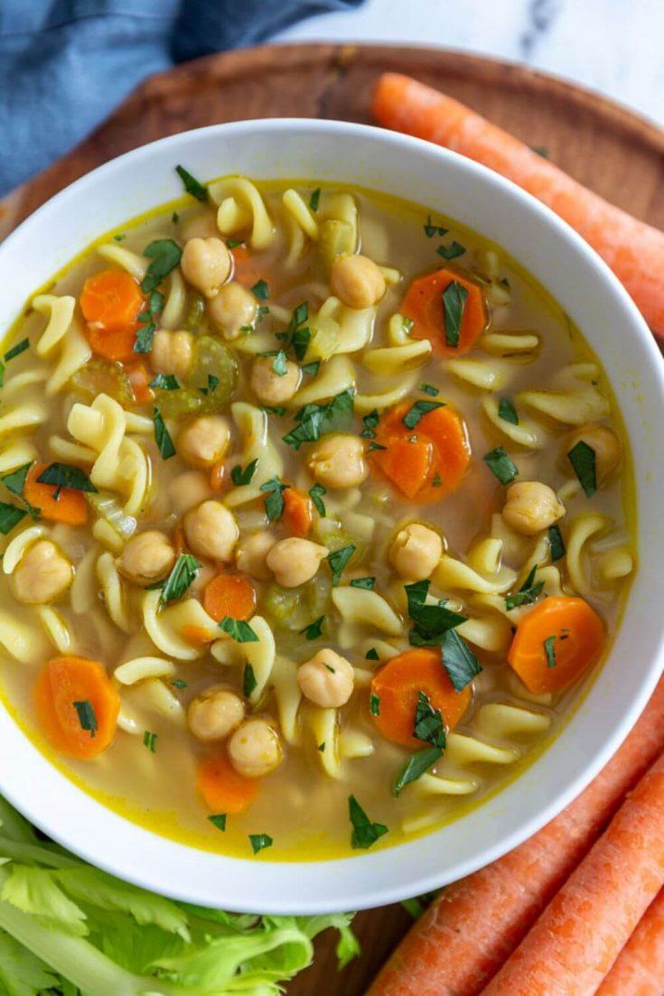 A large bowl of delicious chickpea noodle soup.