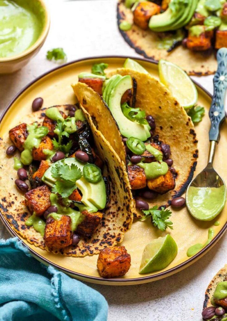 A plate of two chipotle roasted butternut squash tacos.