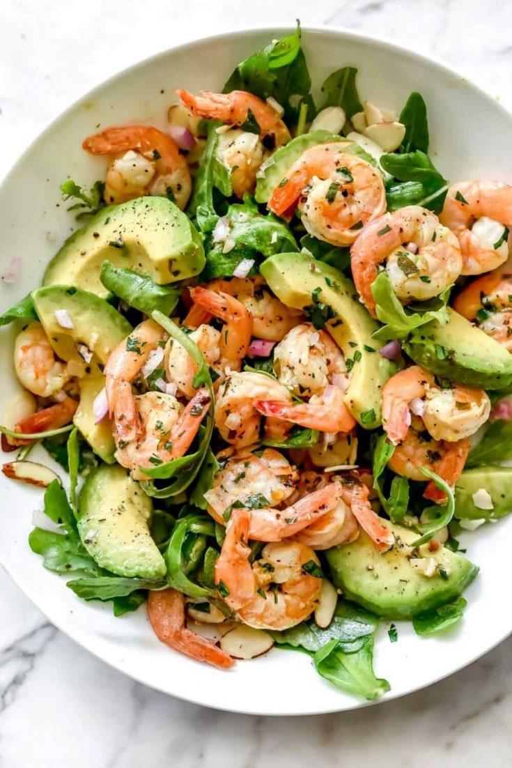 A delicious bowl of citrus shrimp and avocado salad.
