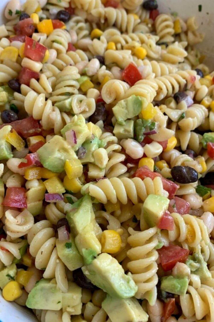 A closeup bowl of cowboy caviar pasta salad.