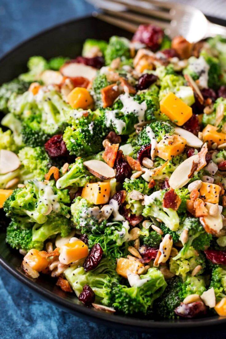 A closeup of a bowl of cranberry almond broccoli salad.
