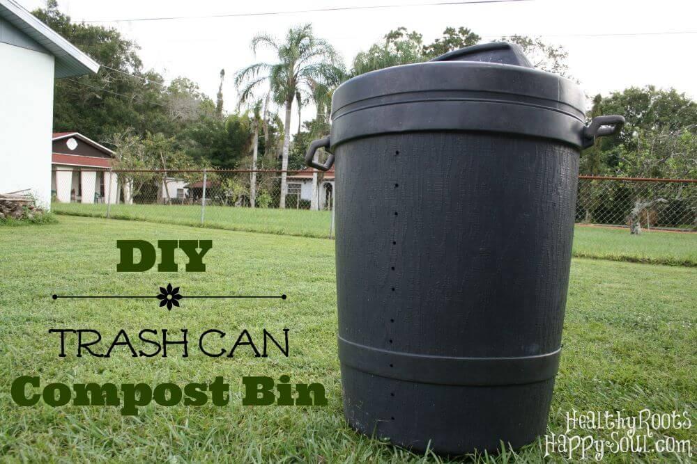 A DIY trash can compost bin in a yard.