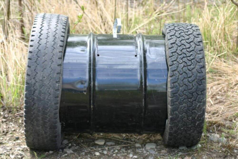 An easy recycled compost barrel made out of tires and a metal barrel.