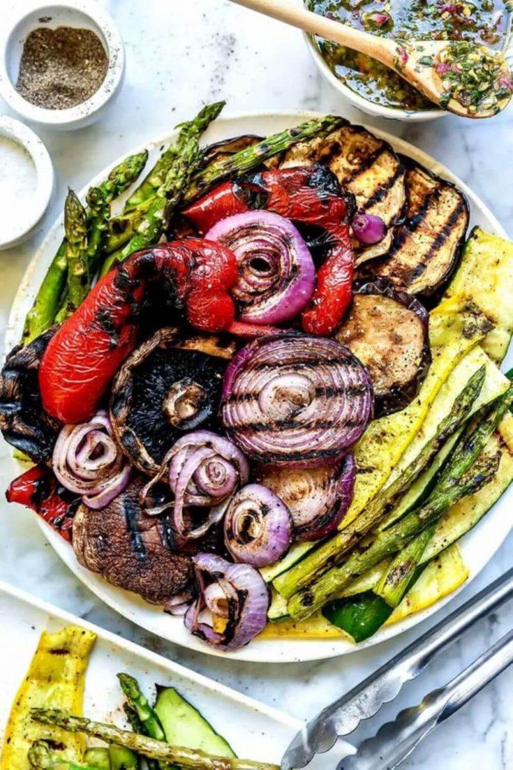 A large platter of colorful grilled summer vegetables.