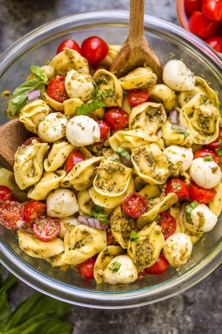 A large bowl of easy pesto tortellini pasta salad.