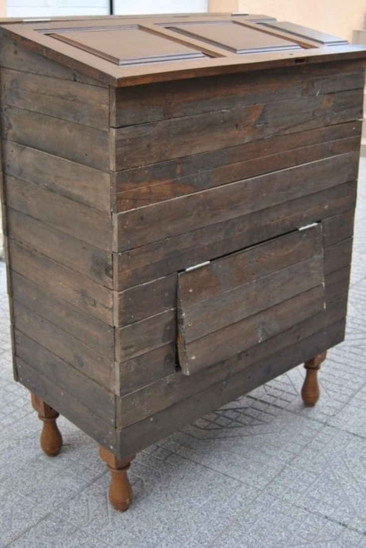 An eco-friendly compost bin made out of an old dresser.