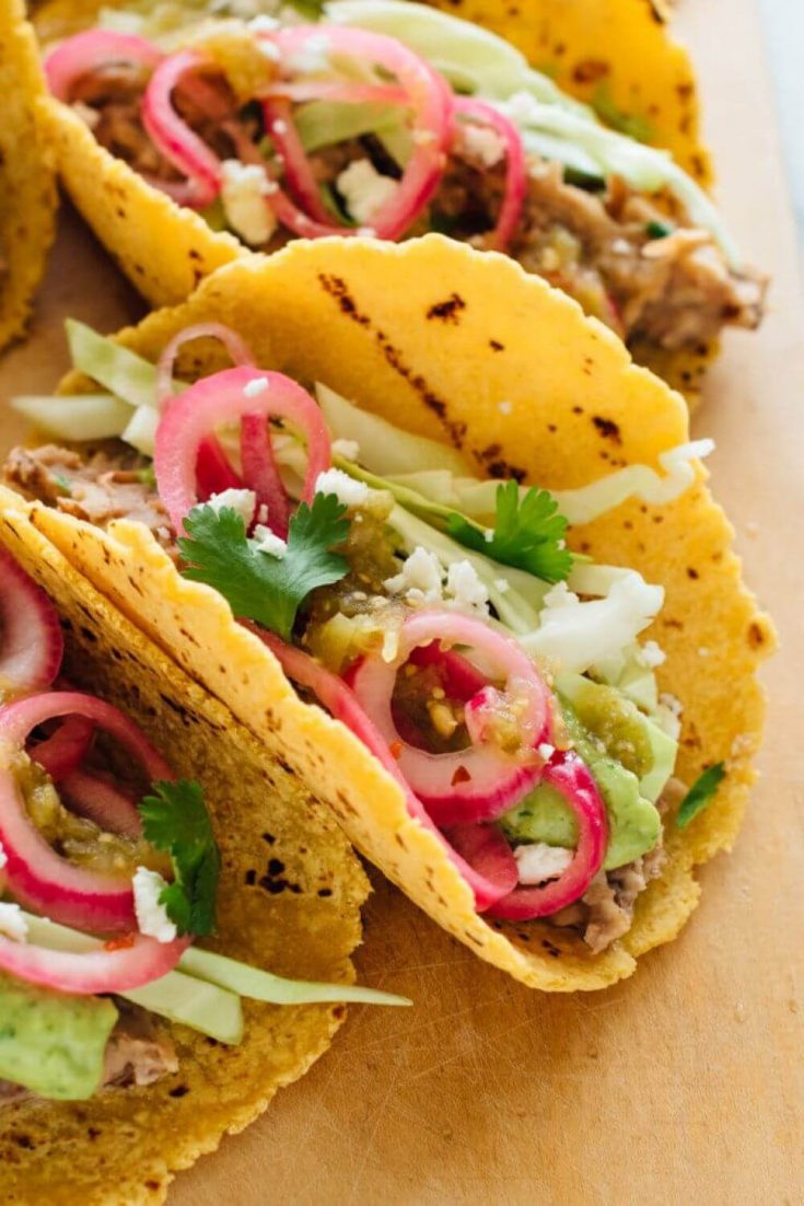 A close-up of some loaded epic vegetarian tacos.