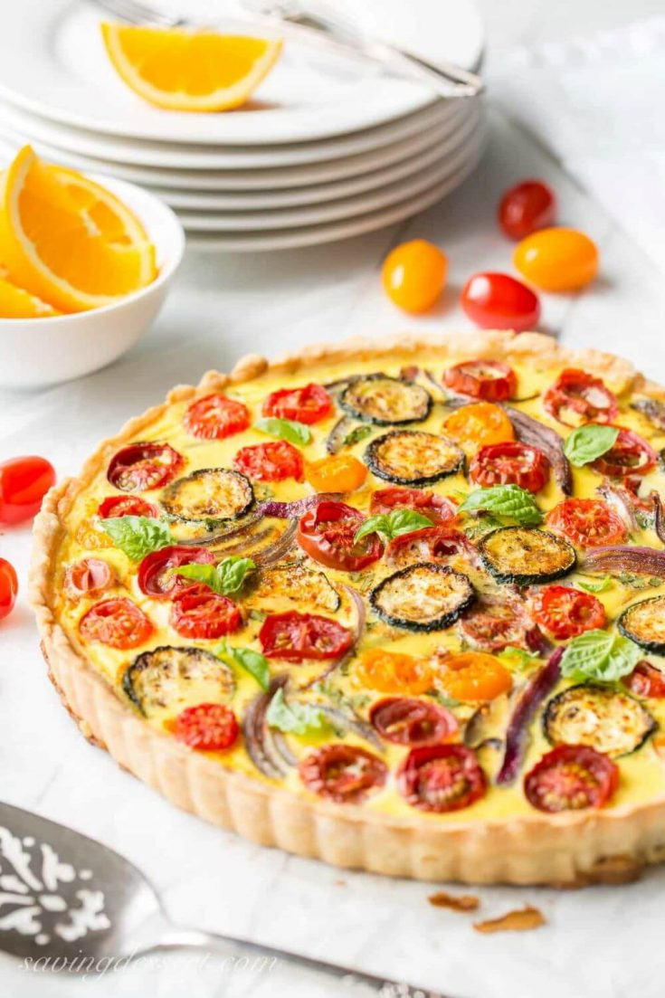A colorful pan of baked farmers market quiche.
