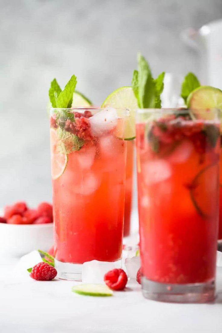 Two full glasses of fresh raspberry mojito.