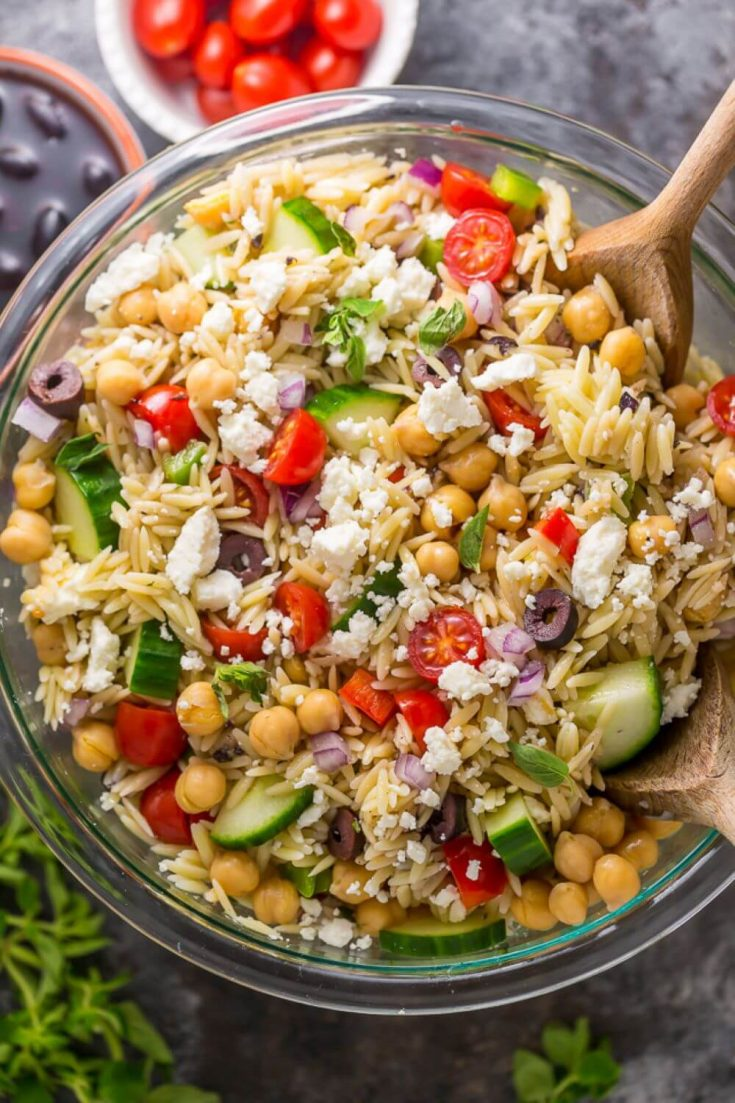 A large bowl of delicious Greek orzo salad.