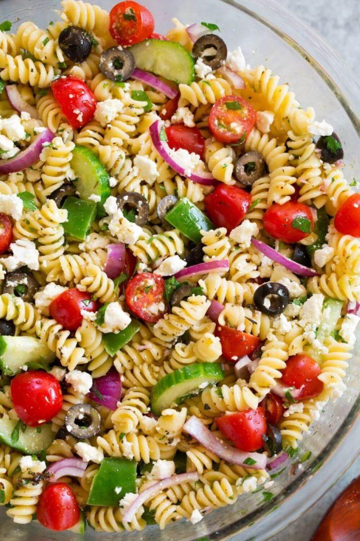 A colorful bowl of Greek pasta salad.