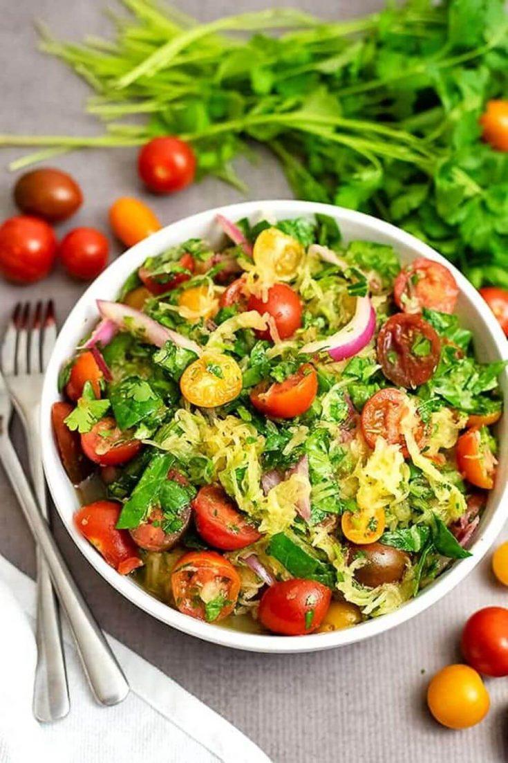 A full and colorful bowl of Greek spaghetti squash salad.