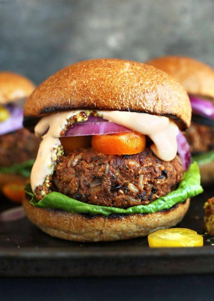 A closeup of a loaded grillable veggie burger on a bun.