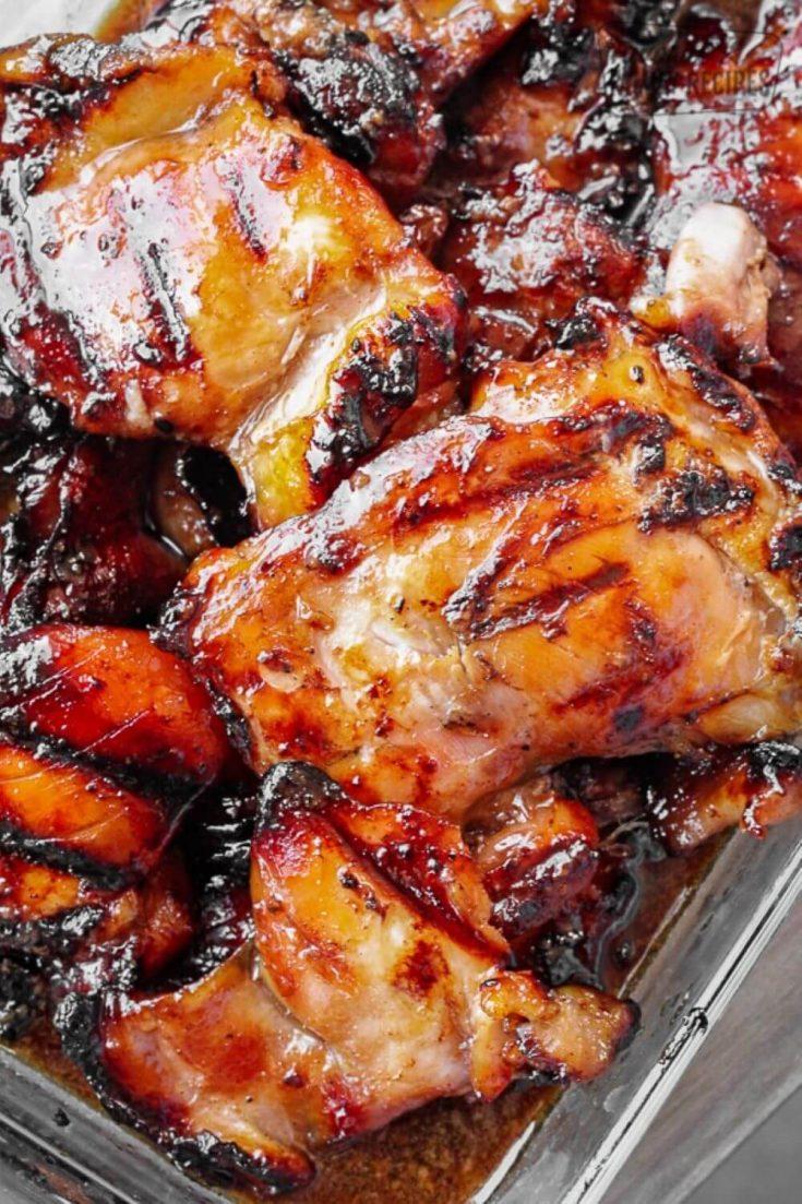A closeup tray of saucy grilled Hawaiian teriyaki chicken.