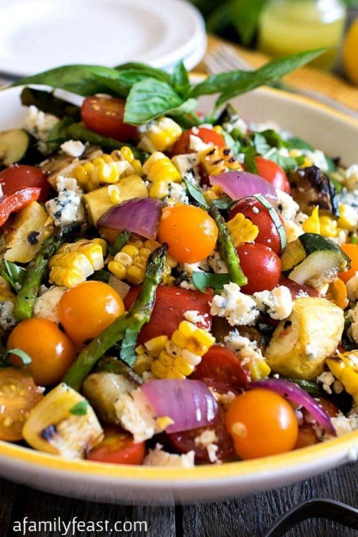 A colorful bowl of grilled summer vegetable salad.