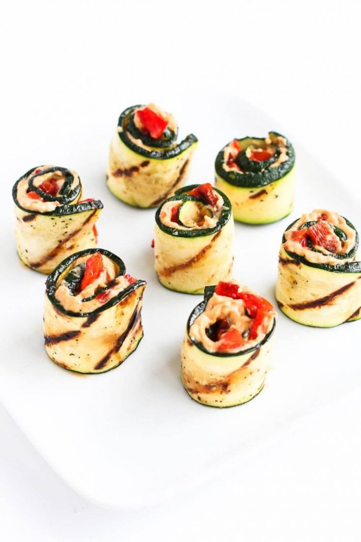 A plate of delicious grilled zucchini hummus roll-ups.