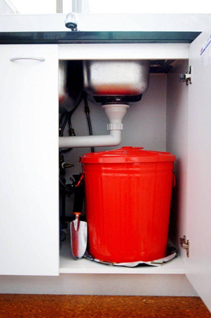 An easy indoor compost bin stored under a kitchen sink.