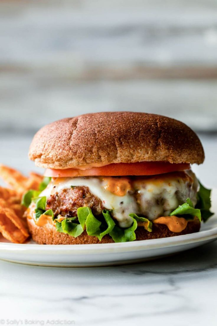 A delicious grilled jalapeno pepper jack cheese turkey burger on a bun.
