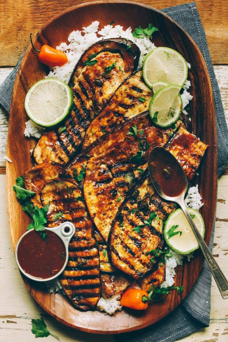A platter of delicious Jamaican jerk grilled eggplant with sauce.