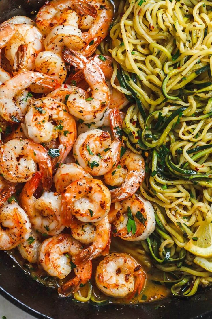 A close-up plate of lemon garlic butter shrimp with zucchini noodles.