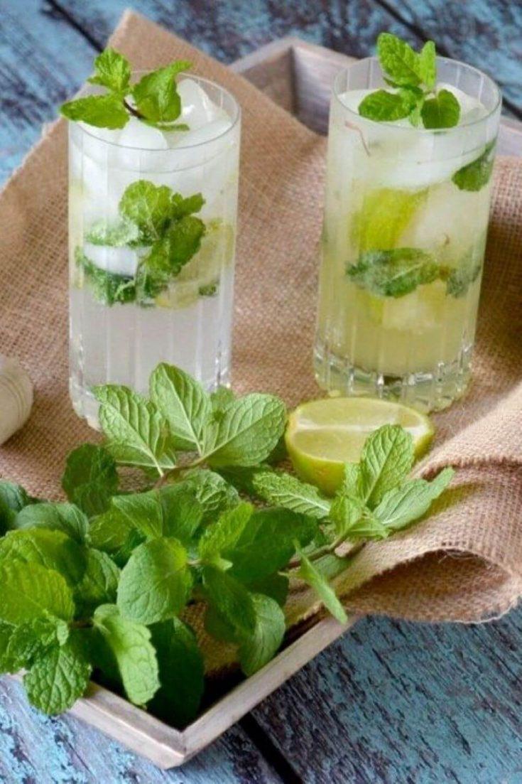 Two full glasses of fruity limoncello mojito.