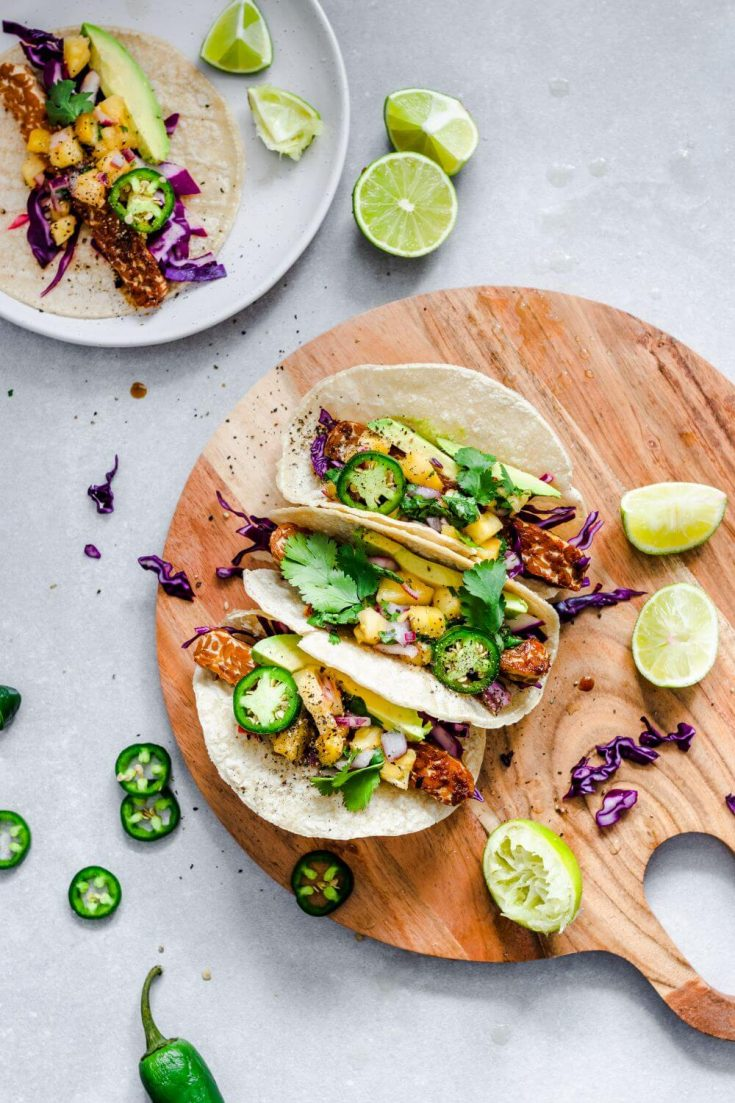 A platter of maple glazed tempeh tacos topped with pineapple salsa.