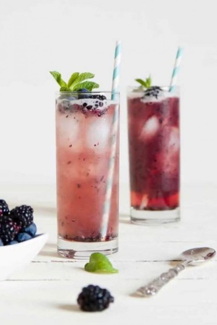 Two full glasses of fruity mixed berry mojito.