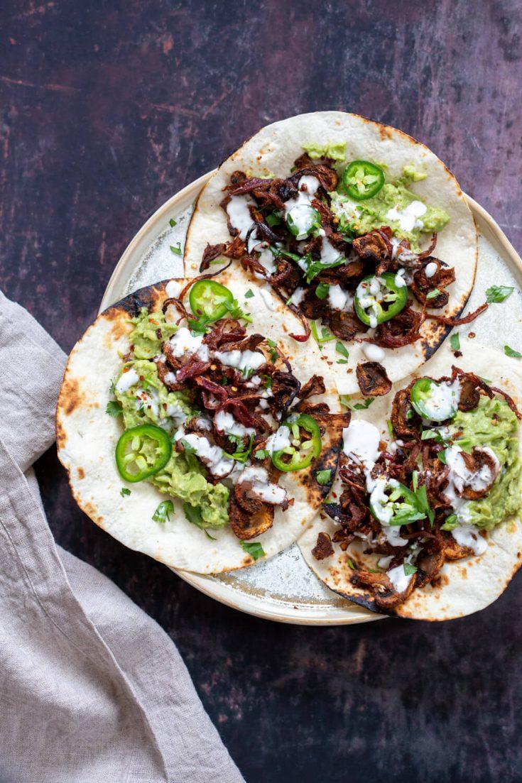 A plate of delicious vegan mushroom carnitas tacos.