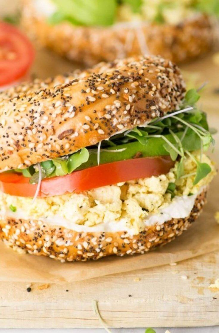A loaded vegan breakfast sandwich on an everything bagel.