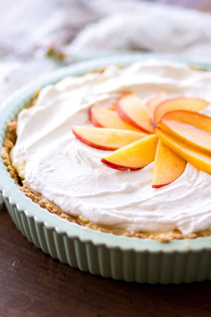 A closeup of a delicious no-bake peach cream pie.
