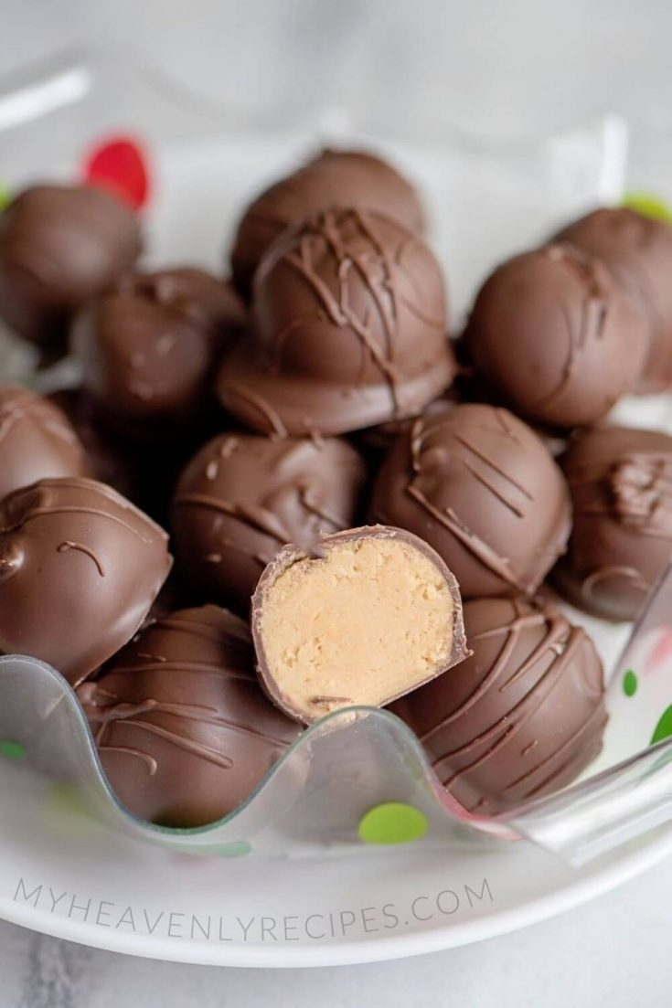 A plate of many delicious no-bake peanut butter balls.
