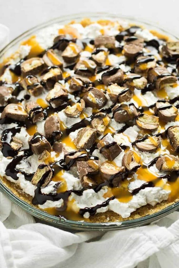 A closeup of a large no-bake twix pie.